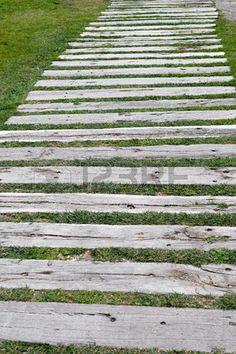 Detail of a garden path of wooden sleepers Stock Photo