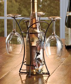 Stunningly sophisticated Metal Wine and Glass Rack adds a whole new level of class to dinners and other social gatherings. Grapevine design is filled with marvelous details. Wine Racks, Wine Glass Holder, Wine Bottle Holders, Wine O Clock, Wine Bottle Wall, Wine Bucket, Wine Education, Steel Art, Wine Fridge