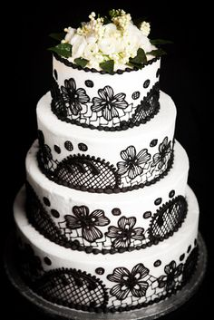 Lunds and Byerly's Wedding Cakes  - Vintage Lace -    Beautiful royal icing embroidery accents this buttercream creation. Black on white is bold and contemporary.