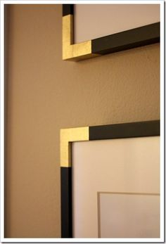 gold corners : she spray painted blue painters tape and attached to frame corners (temporary, in case she changes her mind, and she says texture resembles gold leafing)