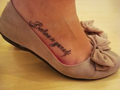 "Side foot tattoo. ""Believe in yourself"""
