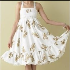 Iconic JCrew Lobster dress Cream with tan lobsters. 100% cotton and fully lined with a petticoat type skirt. Empire waist and criss cross back. I LOVE this dress but only worn a handful of times. J. Crew Dresses Midi