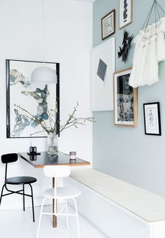 Kitchen nook with a blue wall and artwork