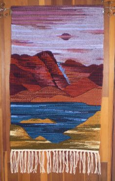 """""""Twilight on the Brazos"""" ... Handwoven in the Rio Grande Tradition (Hispanic) with 100% hand-dyed wool on a large floor walking loom.  This style of weaving was brought to the Southwest by Spanish settlers in the 16th century and is traditional to the people of the middle and upper Rio Grande valleys in New Mexico and Southern Colorado, where I make my home.  This style actually derives from the interweaving of the Spanish, Mexican native, and the local Indian pueblo weaving cultures."""