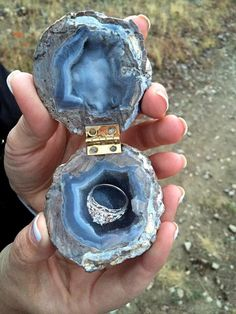 A cool mini rock engagement shell shaped box with a mini engagement ring inside.:).