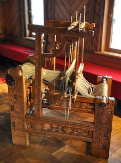 Russian loom of the 16th century. Carving on wood was performed in Russian folk tradition.