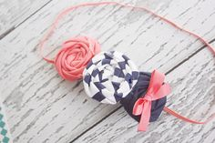 For Autumn?    Toss Me a Line- coral and navy nautical inspired triple rosette headband. $15.00, via Etsy.