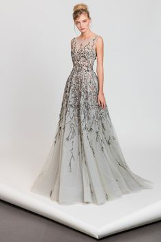 Light blue A-line tulle dress with cascading pink and black embroideries and a sheer neckline.