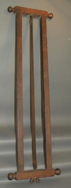 """Framed pit saw 1740-60; with top and lower rails having turned hardwood grasp handles and 3 ¾""""w blade with hand wrought hardware and ram's horn tension nut, 58""""x 17"""";"""