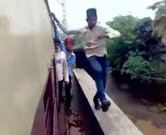 Watch train stunts from Indian(Mumbai) local guys...Its dangerous.