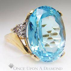 17.05ctw Oval Light Sky Blue Topaz & Diamond Right Hand Gold Ring