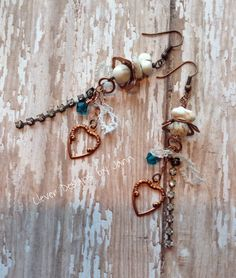 A B'sue Flower was used at the top of these Country Chic May Challenge Chandelier Earrings .. dangling beneath that are a B'sue Heart, Rhinestones and a crystal ..  Country Chic May Challenge Chandelier Earrings .. Jann Tague .. Clever Designs ..  https://www.facebook.com/JewelsByJann