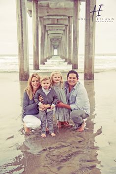 Amazing family under a beach pier in La Jolla
