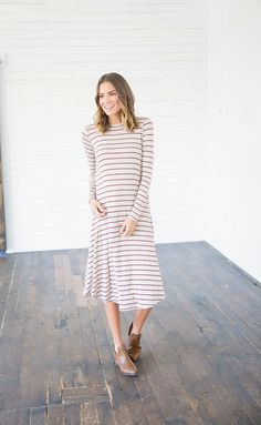 The XOXO Red Striped Midi Dress is a great piece for anyone who loves simplicity! This dress features a tan base with darling red stripe detailing, and a dazzling knee cut length. This dress can be turned into endless outfit combinations. You'll be rocking this dress whether you are going out on a date or just out and about.    Bella Ella Boutique