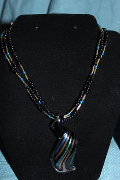 Three Stranded Blue, Green, Black, and Gold Necklace with Glass Pendant! on Etsy, $25.00