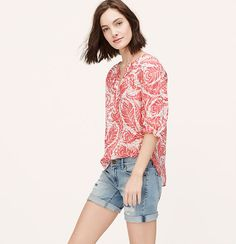 We're swept away by the pretty plumage of this cotton and silk beauty. Split neck. 3/4 sleeves. Drop shoulders. Shirred beneath front and back yoke. Shirttail hem.