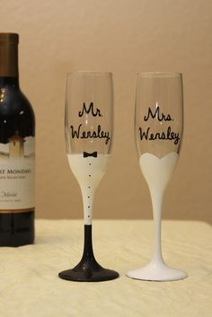 Mr. and Mrs. Wedding Champagne Flutes Painted Glasses. $25.00, via Etsy. Must be a way to DIY for less.