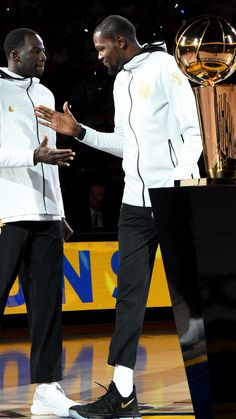 180c719724c4 Kevin Durant and Draymond Green of the Golden State Warriors high five  before they accept their 2017 NBA Championship rings on October 17 2017 at.