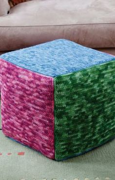 Cube in Tones Crochet Pattern - Create your own four-part harmony with four different shades of yarn! This crocheted ottoman cover is the perfect way to add warmth and color to your surroundings.