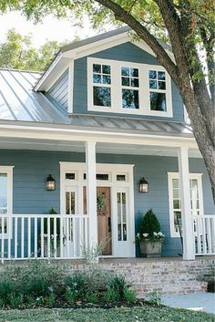 Exterior Update Blue Siding White Trim Wood Door
