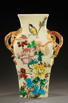 THEODORE DECK (1823-1891) A rare and exceptional white enamelled ceramic vase with polychrome motifs and two large handles in the shape of branches.Signed «TH.Deck». Circa 1880-1890.