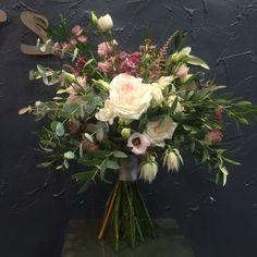 Wedding Bouquet: White O'Hara Roses, Blush Pink Lisianthus, Burgundy Astrantia, Blushing Bride Protea, Eucalyptus, Olive Leaf, Blush Pink Astilby, White Freesia