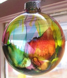 """DIY Alcohol Ink Ornament (alcohol ink, glass balls, canned air)..""""Alcohol Ink Ornaments Tim Holtz, the guru of all things alcohol ink-related, has a video tutorial for alcohol ink splatter ornaments. These are almost too easy to make. After you gather your supplies, you'll be able to crank these out in under 5 mins. Better yet, there's really no way to mess them up. Each one that you create will be unique."""""""