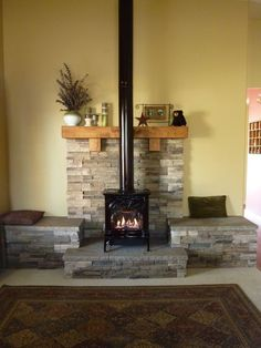 Propane fireplace. We had this hearth built to give more presence to the fireplace. The whole room is very inviting now.: