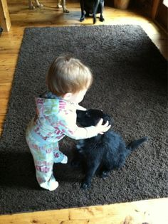 Miss B (Brooklyn Newman) lovin' on their newest foster puppy. 02/05/12