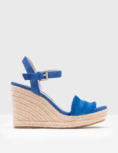 Whether you're sipping beachside sangrias or barbecuing in the back garden, espadrilles make the perfect warm-weather companion. A wedge heel and suede straps keep you comfortable, while the fringed detailing across the toe adds a touch of playful charm.