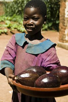 Girl with Giant Avocados, Malawi |