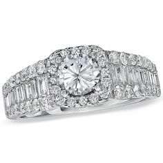 Brides.com: Angelina Jolie's Engagement Ring: Get the Look.  Style 18637678, 14k white gold and diamond framed ring with round diamond center stone and baguette sides, $5,700, Vera Wang LOVE Collection See more over-the-top engagement rings.