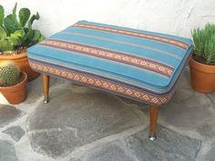 Mid Century Modern style ottoman or footstool upholstered with blue Southwestern Stripe fabric (Sandoval Serape) with tapered wooden legs by territoryhardgoods
