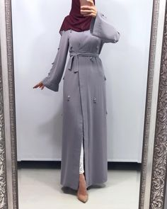 Elegant And Modern Abaya Designs Muslim women today are no longer restricted to wearing the abaya the traditional way only. The world of abaya fashion is changing rapidly, more than it ever has in the past. That is partly due to a…Read Hijab Style Dress, Hijab Chic, Hijab Outfit, Abaya Style, Eid Outfits, Modest Outfits, Fashion Outfits, Muslim Women Fashion, Islamic Fashion
