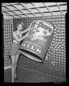 Got a (giant can of vintage) milk? This lovely lass does! :) #vintage #1950s #fifties #women #milk #photography #ads
