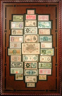 Collection of international currency in a Bradley's custom frame. Perfect to showcase a world traveler's adventures.