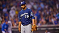 Brewers pitcher Wily Peralta wipes out during pregame ceremony