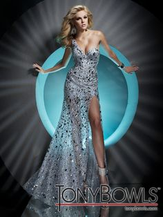 One-shoulder sequined mesh slim A-line pageant dress with single shoulder strap, sweetheart neckline, sheer overskirt with side slit reveals short underskirt, sweep train. Sizes: 0 - 20