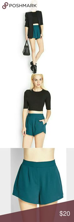"""F21 Green Shorts A beautiful shade of green!!! Elastic waist back, pockets, and flat pleats. About 13"""" waist to hem, 3"""" inseam, and 15"""" across waist; laid flat and unstretched. No trades! EUC Forever 21 Shorts"""