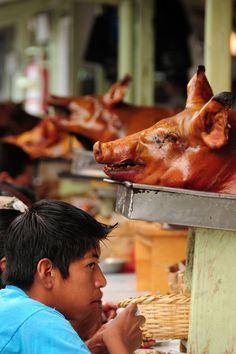 Roasted pig, Otavalo market, Ecuador. and Riobamba City