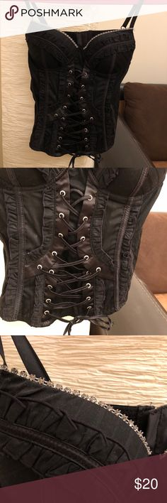 Black corset/top. Great condition, size Small Black corset. Worn only a few times. Great condition Tops