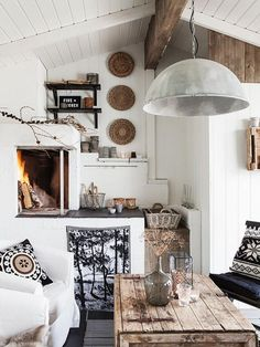 love the corner fireplace. Looks great for a small house.I love the brown accents with wood