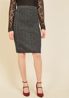 <p>Yet again you've styled this cable-knit skirt impeccably, and yet again your pals call dibs on who gets to borrow it next. You had better live up the elasticized waistband and charcoal grey hue of this standout separate before it travels through your friends' wardrobes once more!</p>