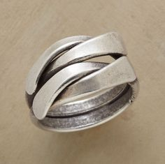 Our fool-the-eye ring looks like twin lengths of sterling twisting around the finger, but the two are forever joined. A Sundance exclusive in whole sizes 5 to 11.