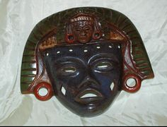 Teotihuacan Mexico Handcrafted Mexican Pottery Clay Warrior Mask with 2 faces .   As you can see there is a little face above the main face. Not sure what the meaning is but from references I have...