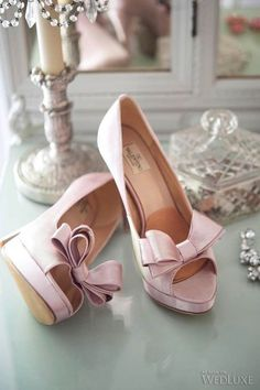 Valentino pink bow, peep-toe pumps.