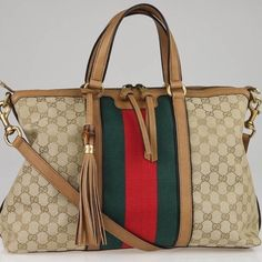 Gucci Rania Original Gg Canvas Top Handle Bag Retail price $1950 + tax  Brand new, never carried! 100% Authentic purchase from the Gucci Store San Diego in 2013. Extremely hard to find and no longer available at Gucci, comes with original box and dust bag! Box is a little dusty from being in storage. For serious buyers only! Perhaps a collector. I will not entertain anything less than what its worth  ❗️ABSOLUTELY NO TRADES, NO HOLDS, NO LOWBALLS  ❗️Do not promote or post advertisement on my…