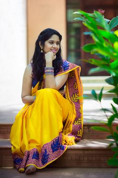 Traditional yellow kanchipuram silk saree contrasted with pink cutwork reflects royalty!