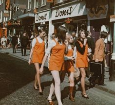 Girls wearing pinafores on Carnaby Street, 1960s.