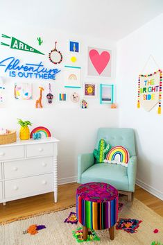 a whitewashed nursery with playful, rainbow-inspired details